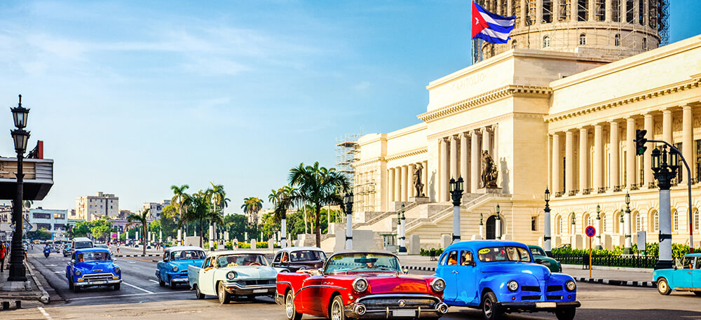 Classic taxis in front of the capitol in Havana