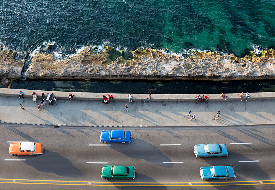 Aerial view of cars in the malecon of Havana