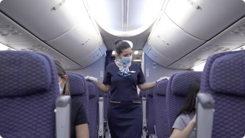 Stewardess with passengers
