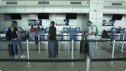 Passengers keeping their distance while queuing for check-in